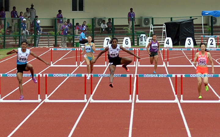 India_s_Anu_R_right__and_Jauna_Murmu_centre__in_action_during_the_Womens_400m_Hurdles_Heat_2_at_the__800805